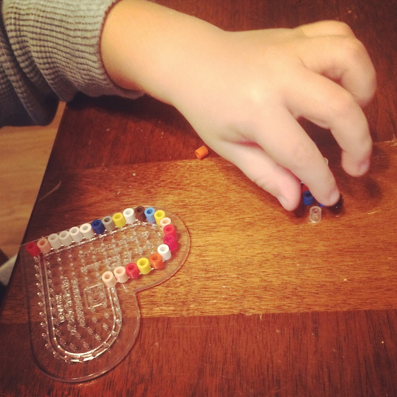 A boy and his bead project. My 3yo's favorite morning activity.